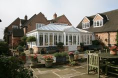 Outside view of a large Everest white uPVC Conservatory