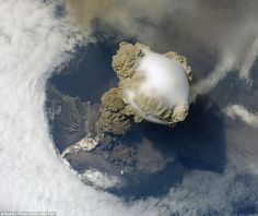 Pileus cloud above the Sarychev volcano as it erupts, in the Kuril Islands, Russia: Pileus clouds are small clouds that form on top of a bigger cloud. In this photo a pileus cloud (centre) has formed above a cloud of volcanic ash from the Sarychev volcano. A large plume of smoke, steam and ash is erupting from the volcano while pyroclastic flow of denser ash descends the volcano sides. The snap was taken by astronauts aboard the International Space Station