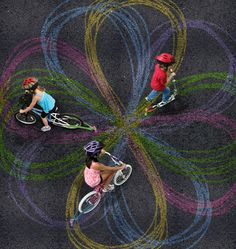 Creating chalk trails behind the kids bikes & scooters