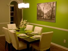 Pair a neutral slipcover with colorful table settings to create your own high-style dining room. Complemented by a bold focal wall, these crisp, white slipcovers look especially lovely with lime-green accessories. Design by HGTV fan mfranc