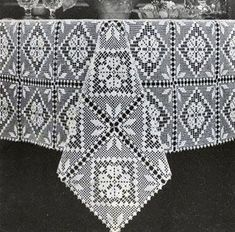 Filet Tablecloth crochet pattern from Fair, Bazaar and Gift Crocheting, originally published by Lily Mills Company, Book 63.