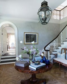 The foyer of Emilia Fanjul Pfeifler's Locust Valley, Long Island, NY home features antique French oak floors and a Scottish lantern. South Shore Decorating, Foyer Decorating, Decorating Blogs, Long Island, Decoration Entree, Colonial Style Homes, Entry Hallway, French Oak, Beautiful Interiors
