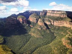 TheThree Rondavelsare three round mountain tops with slightly pointed tops very similar to the traditional round or oval African homesteads made with local materials called rondavels. They are one of the major icons of theMpumalanga Province South Africa. Homesteads, South Africa, Grand Canyon, Anna, Mountain, African, Icons, Traditional, Travel