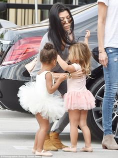 Tutu cute: Both of the girls were dressed in tutus, with Penelope wearing a pink one an North in white