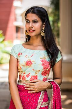 Another cooly combined number! A floral blouse with a slim plain silk yoke and floral piping details. Don this beauty for a simply chic appeal.Any saree in one of the floral colours, or even a black saree to make a bold statement. #Pistagreen #floral #blouse #India #Saree #houseofblouse