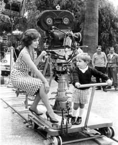 """Gina Lollobrigida and her son, Milko Skofic Jr., ride the camera trolley on the set of  """"Come September"""" (1961)"""