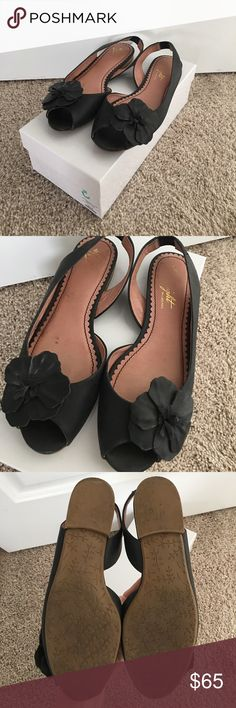 Anthropologie Black Peep Toe Flats, 7 1/2 Anthropologie Miss Albright black peep toe flats with cute flower detail. In great condition!!  Want to keep but they are just too small for me since having babies!  Only wear is on footbed and bottom, see pics. Leather with nonskid bottom. Anthropologie Shoes