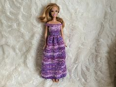 I hope you enjoy this fun crochet pattern for an off-the-shoulder Barbie dress. My tiny fashionista daughter wanted a new dress for her Barbie and she specifically requested a ball gown. I designed this for her and she was very happy with the way it turned out. Sparkly and purple, what's not to love?