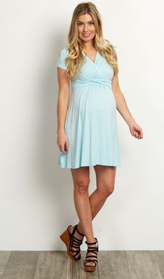 Look no further for a cute nursing dress you can look and feel great in. This classic draped front style makes nursing easy with a v-neckline and a cinched under bust style gives you a flattering silhouette. Style this maternity dress with leggings and flats or boots for a perfect casual outfit.