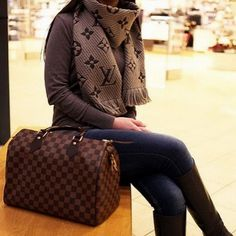 This Louis Vuitton Handbag is Gorgeous! I wouldn't mind the scarf either :)