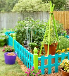 colorful-garden-fence - A great way to make a small 'growing area' look more bright and cheerful - even when it's at the stage where it's just mud and a few shoots!