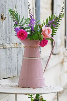 pretty pink pitcher with beautiful flowers