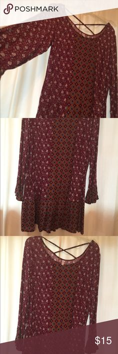 2X Xhilaration Tunic with a burgundy paisley print 2X Xhilaration Tunic with a burgundy paisley print, 3/4 quarter sleeves, side pockets and ruffles on hem and sleeves, perfect with leggings or skinny jeans. NWOT - tags removed but never worn. Xhilaration Tops Tunics