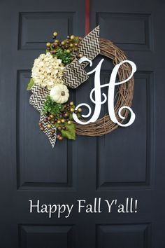 A rustic & charming Fall Wreath wreath decorated with Fall Berries, white pumpkin & antique white Hydrangea bloom
