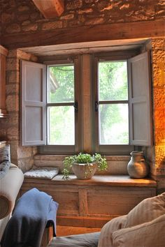 very sweet window nook. I have wanted a window seat ever since I was a little girl. One where you could curl up and read a book. Indoor Shutters, Wooden Shutters, Window Benches, Window Seats, Interior Shutters, Cabins And Cottages, Stone Cottages, Cool House Designs, Windows And Doors