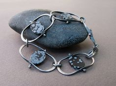 Forged Chain Bracelet in Sterling Silver and Snowflake Obsidian.