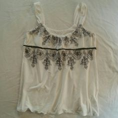 Calvin Klein Tank This white tank is so cute with black embroidered leaf detail ! Only worn 2 or 3 times and washed by hand. 100 % cotton. No flaws . Calvin Klein Tops Tank Tops