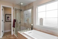 Traditional Full Bathroom with limestone tile floors, Drop-In Bathtub, frameless showerdoor, Handheld Shower Head