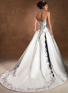 I love the black accents on this dress. David's Bridal.