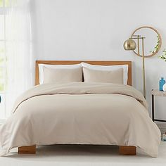 Soft and indulgent, this 450-Thread-Count Duvet Cover Set gives your bedroom a clean and classic look in one solid color. Made of cotton sateen for a superior comfort and style, the set includes a duvet cover and matching pillow shams.