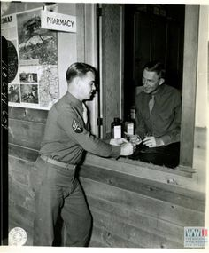 PHARMACY WINDOW OF MEDICAL DETACHMENT DISPENSARY AT CAMP SAN LUIS OBISPO, CALIFORNIA ON 25 FEBRUARY 1944 (From the collection of The National World War II Museum) https://www.facebook.com/VintagePharmacy/posts/1693782304277204:0