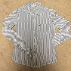 Hollister shirt Never wear since the size is too small for me. Hollister Tops Button Down Shirts