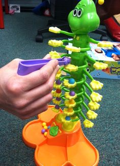 Scatterpillar Scramble: Love this game for working on fine motor skills (hand strength and tripod grip). -- Repinned by @PediaStaff – Please Visit  ht.ly/63sNt for all our pediatric therapy pins