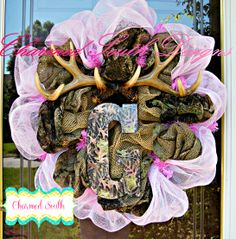 In the South, nothing says fall like a hunter wreath. This one is for a baby girl. Mossy Oak accented with pink mesh.  Come join us at www.facebook.com/charmedsouth www.charmedsouth.etsy.com
