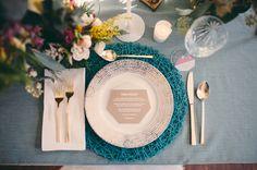 teal string art charger, photo by JBM Wedding Photography, styling by Tinsel & Twine http://ruffledblog.com/bold-geometric-wedding-inspiration #weddingideas #reception #placesetting