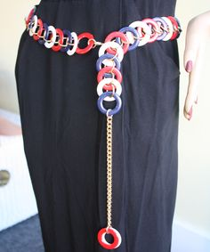 Vintage 60s 70s Patriotic Colors Plastic Disk Mod Belt This fun mod era vintage chain belt has a patriotic blend of colors in red, white, and blue.  It is made by overlapped plastic circle disks linked with golden toned oval wires.