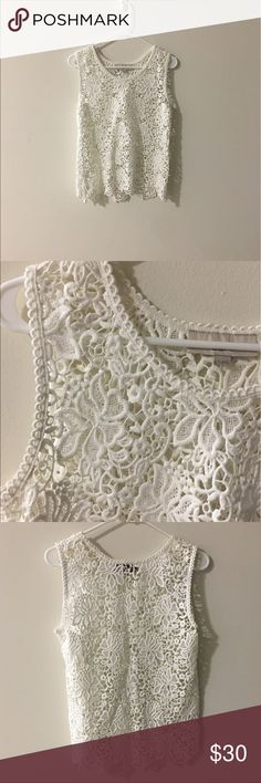 Lace Top White floral pattern lace top. It doesn't have its tags, but it's never been worn. LOFT Tops