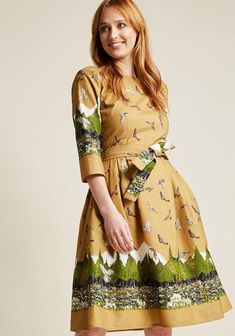 Birds of Prey Whether you're picnicking in the park or visiting a local historical treasure, you'll look your best in this deep mustard dress from Palava. With this cotton twill dress comes a paperback book that details the story playing out across your poc
