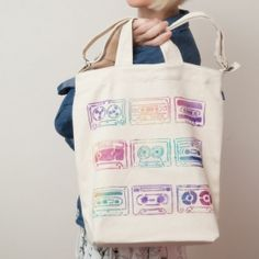 Have fun creating and personalizing your tote bag with a stencil and fabric spray paint.