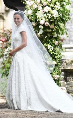 Pippa Middleton has arrived for her wedding wearing a spectacular lace-bodiced, high necked wedding gown created by Giles Deacon. #weddings #weddingdress