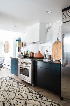 black cabinets, white hood in the kitchen