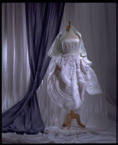 """John's Galliano's collection """"Blanche Dubois""""1988 was inspired by the protagonist; Blanche Dubois from the modern play/film """"A Street Car Named Desire""""; written by Tennesse Williams. He then won the British Designer of the year award and the Dress of the year award from Bath Museum of Costume."""