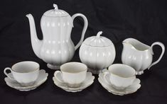 Josef Hoffmann Mocca coffee service Augarten, Wiener Porzellan-Manufaktur Made in Austria, c. 1933, designed by Hoffman in 1925 White, glazed porcelain set.Ribbed with gold leaf accents. Set includes: 1x coffee pot 1x creamer 1x sugar bowl 3x cups& saucers 9 Items in total. Stamped Augarten and Wien, no export marks or stamps