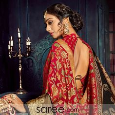 This richly woven chiffon brasso saree is a lovely blend of traditions and modest glamour! With the classic combination of red and black with grey, the chiffon sari spells elegance and style. Generously adorned with flower vines and paisley forms, the red Saree Blouse Designs, Blouse Patterns, Simple Sarees, Lehenga Choli Online, Red Chiffon, Exclusive Collection, Paisley, Sari, Blouses