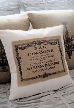 Vintage Perfume Label Burlap and White Cotton Pillow Slip. $38.00, via Etsy. SOLD but I wanted to pin so I could refer back to see what they look like she made a ton