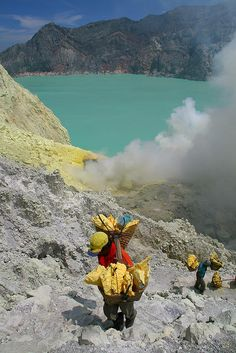 WOW should we in North America ever count our MANY blessings...Workers carrying sulphur up from Kawah Ijen - Indonesia
