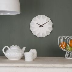 The Origami clock is crafted from ceramic and the design cleverly reflects both light and shade to add a fantastic sculptural element to your wall. Design Origami, Classic Clocks, Cool Clocks, Minimal Home, Minimalistic Kitchen, Wall Clock Design, Scandinavian Home, Decoration, White Ceramics