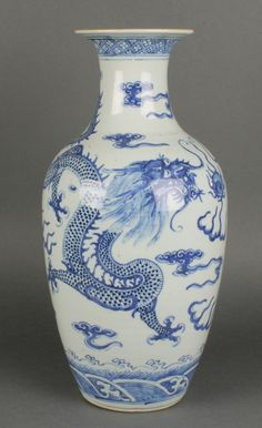 """Lot 121, A late 19th Century Chinese oviform vase with waisted neck, the blue and white decoration with dragons chasing the flaming pearl 17"""" Est £50-100"""