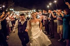 "couple leaves wedding with sparklers, sparklers are definitely the ""new rice"""