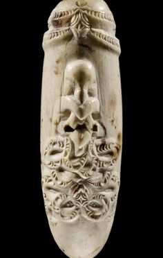 This is a nguru, a nose flute or whistle, made from whale ivory around 1800