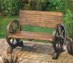 Wagon Wheel Garden Bench - Laze in the shade after a long day; this rustic Wagon Wheel Garden Bench is right at home on patio porch or lawn. Wagon Wheel Garden, Wagon Wheel Bench, Wagon Wheel Decor, Rustic Bench, Rustic Wood, Rustic Garden Decor, Teak Wood, Barn Wood, Wooden Wagon Wheels