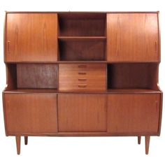Stunning Mid-Century Danish Teak Sideboard by Poul Jessen | From a unique collection of antique and modern sideboards at https://www.1stdibs.com/furniture/storage-case-pieces/sideboards/