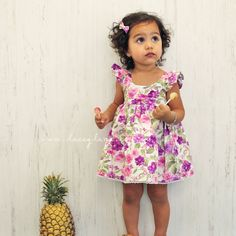 Evelyn Dress Kit by Lacey Lane -Comes with matching headscarf, large bow clip and mini bow clips -Made from 100% cotton -Detailed gathered sleeves -Pink/ Purple Floral fabric with detailed lace trim -Tie up adjustable sleeves -Elastic back -Regular fit Model is wearing a size 2.