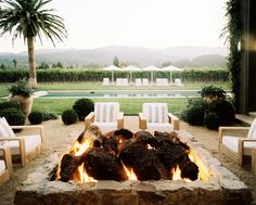 Outdoor fire pit in Napa Valley designed by Hillary Thomas Cool Fire Pits, Diy Fire Pit, Fire Pit Backyard, Outdoor Rooms, Outdoor Living, Outdoor Decor, Napa Valley, Rustic Patio, Real Fire