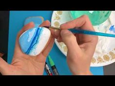 How to paint beach painted rocks. Paint fun waves onto stones with this video tutorial. Create waves using paint pens or acrylics and a paint brush.