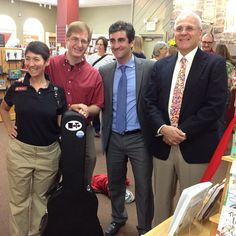 """From L to R: Phoenix Books co-owner Renee Reiner, Nato, #BTVmayor Miro Weinberger (whom I like referring to as """"Mayor Dubs"""", just 'cuz it sounds cool), and Phoenix Books co-owner Mike DeSanto. Pic taken by Rich Nadworny at grand opening of #BTV store!     And here's the video of me playing """"Get Along, Amazon"""" at the ceremony: http://ow.ly/bzG52    Consider being part of the indie new bookstore excitement and helping your community grow strong: http://JoinPhoenix.com"""